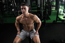 Muscular Man Resting After Exercises - Portrait Of A Physically Fit Young Man In Gym