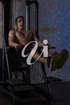 Young Man Performing Hanging Leg Raises Exercise - One Of The Most Effective Ab Exercises