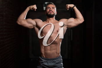 Portrait of a Young Physically Fit Model Showing His Well Trained Body - Muscular Athletic Bodybuilder Fitness Man Posing After Exercises