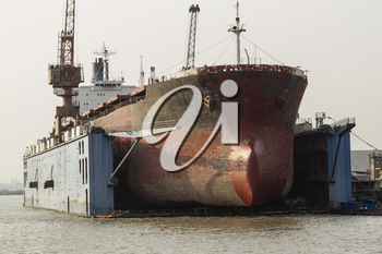 Old Cargo ship docked for hull maintenance in Chinese Harbor
