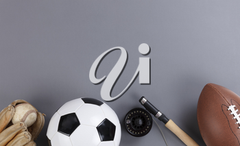 Fathers day concept with a variety of sports equipment on a gray background in flat lay format