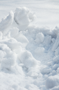 Snow drifts removal,  background, closeup.