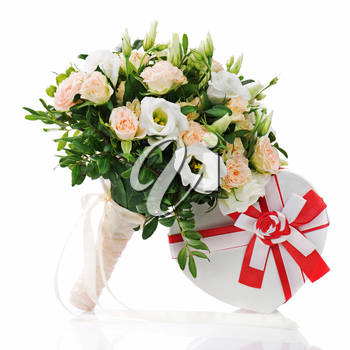 Bouquet for bride of roses, eustomy and pistachios with a wedding gift isolated on white background.