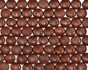 Dark brown dragee in chocolate covered. Whole background.