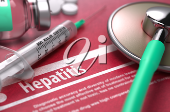 Hepatitis - Medical Concept with Blurred Text, Stethoscope, Pills and Syringe on Red Background. Selective Focus.
