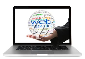 Transparent ball with inscription web marketing in the hand from display of laptop
