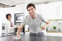 Young Couple Cleaning Cleaning Modern Kitchen