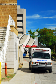 Ambulance in from of Emergency entrance of a hospital