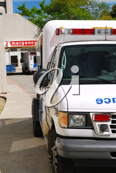 Abmulance vehicle in front of an emergency entrance to a hospital