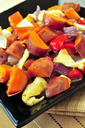 Vegetarian dish of roasted yams with cheese and peppers