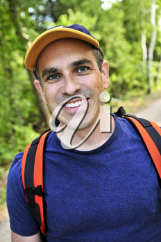 Portrait of happy middle aged man on a forest trail