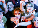 Crowd cheering - their rock idol or simply having fun in a club or disco party