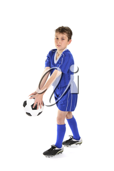 A boy plays with a soccer ball.