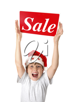 An excited boy holding a sale sign over his head, suitable for pre or post Christmas sales.