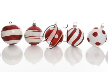 Red and white Christmas baubles with various designs on a white background.