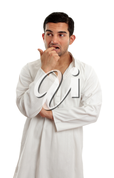 A worried, anxious or nervous man thinking.  He is wearing traditional cultural clothing.