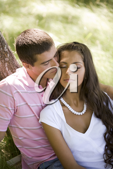Image of tender man kissing girl�s face while spending time together
