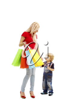 Image of pretty female holding bags full of presents or shoppings with her son near by