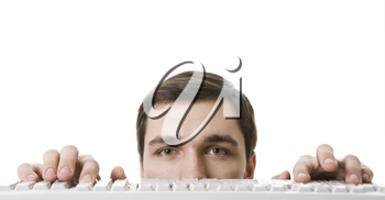 Photo of face of businessman near white keyboard