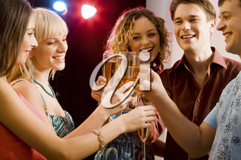 Portrait of five happy people holding glasses of champagne making a toast