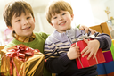 Portrait of siblings holding presents while in supermarket