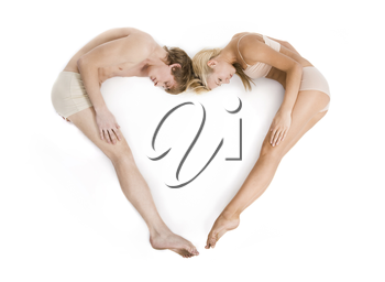 Creative image of couple lying and forming heart over white background