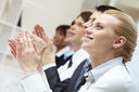 Photo of business partners hands applauding at meeting with pretty blonde at foreground