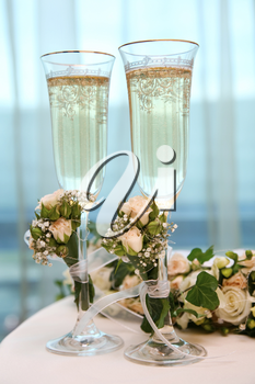Image of champagne flutes on the table while wedding