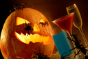 Image of Halloween pumpkin with spiders on it and strange drinks near by