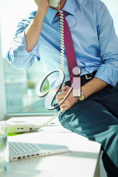 Close-up of businessman calling by phone in office