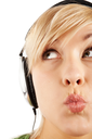 Close-up of a careful girl�s face in headphones