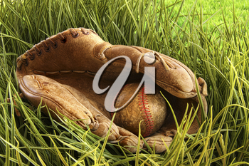 Royalty Free Photo of an Old Leather Ball Glove and Ball