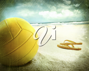 Royalty Free Photo of a Ball With Sandals in the Sand
