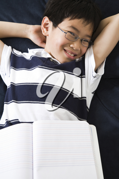 A shot of an asian kid studying at home