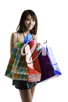 An isolated shot of an asian woman carrying shopping bags