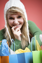 A beautiful happy caucasian girl with shopping bags