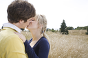 A young caucasian couple in love kissing outdoor