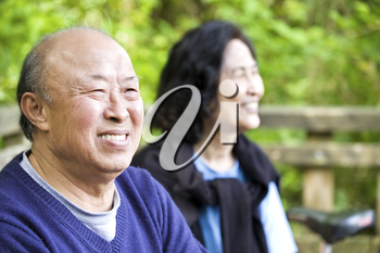 A shot of a couple of happy asian senior outdoor
