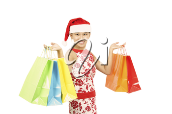 A pretty woman wearing santa hat carrying shopping bags