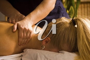 woman at a day spa getting a neck rub