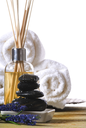 massage stones and towels spa tools and oil