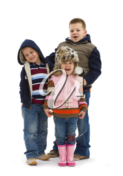 Group of 3 happy children posing together, smiling. Isolated on white background.