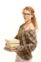 Pretty girl wearing glasses with books, studying for exame.