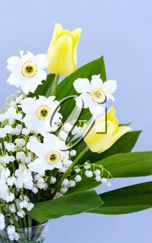 Spring bouquet of tulips, daffodils and lilies of the valley