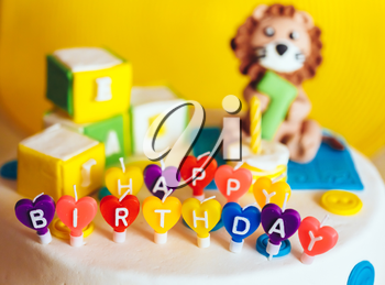 Happy Birthday Written In Candles On Colorful Cake Background