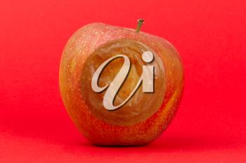 One bad red apple isolated on a red background