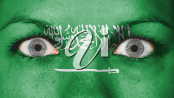 Close up of eyes. Painted face with flag of Saudi Arabia