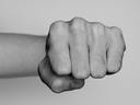 Fist of a man punching, black and white