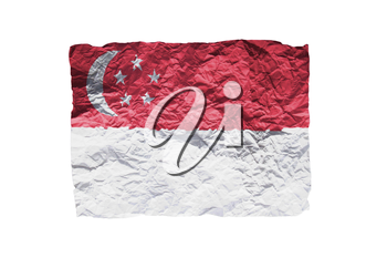 Close up of a curled paper on white background, print of the flag of Singapore