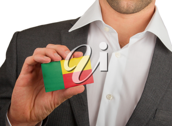 Businessman is holding a business card, flag of Benin